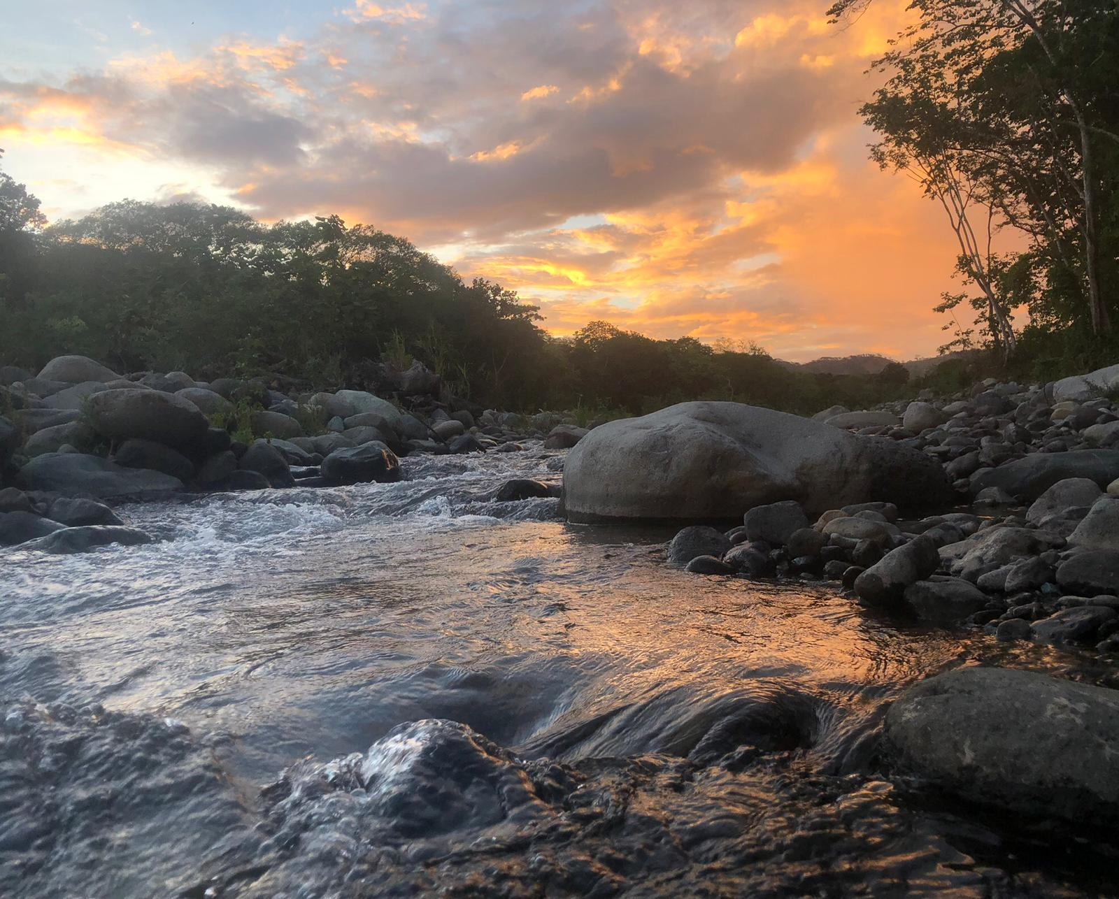 peaceful river sunset sustainability costa rica